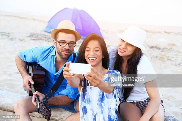Friends having fun while camping on beach