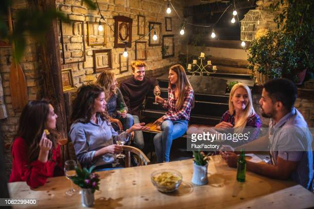 friends having fun while having drinks at a house party - escapism stock pictures, royalty-free photos & images