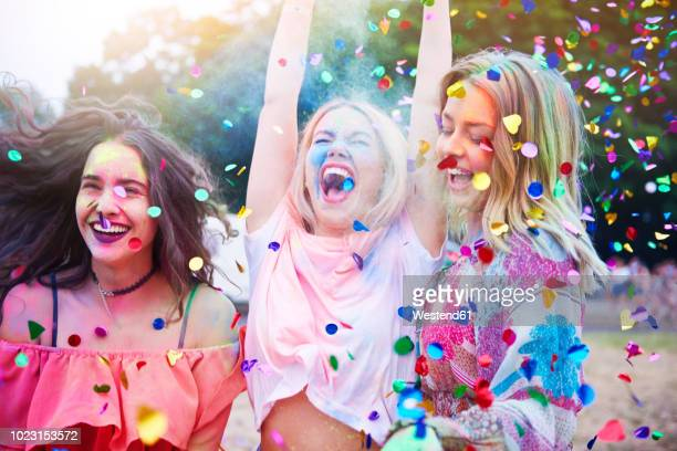 friends having fun with holi powder and confetti - eccitazione foto e immagini stock