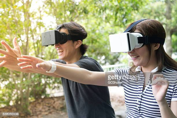 Friends having fun with Virtual Reality Consoles
