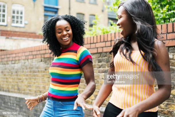 friends having fun/dancing - multi coloured stock pictures, royalty-free photos & images