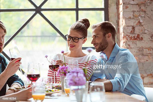 friends having lunch in the restaurant - izusek stock pictures, royalty-free photos & images