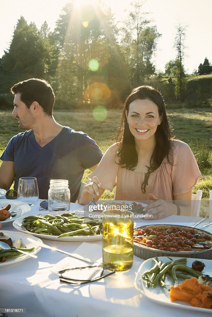 Friends having lunch outdoors : Stock Photo