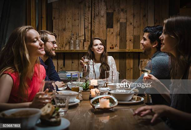 Friends having meal at restaurant