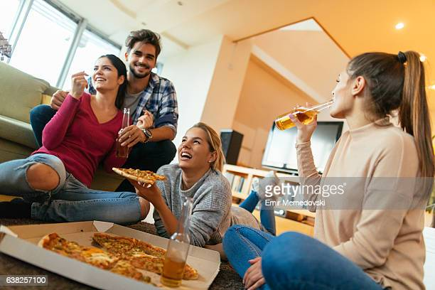 Friends having party with pizza, beer and good company