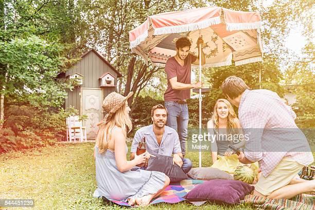 Friends having picnic in garden