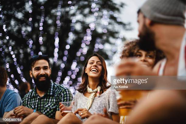 friends having some beers at a concert. - concert stock pictures, royalty-free photos & images