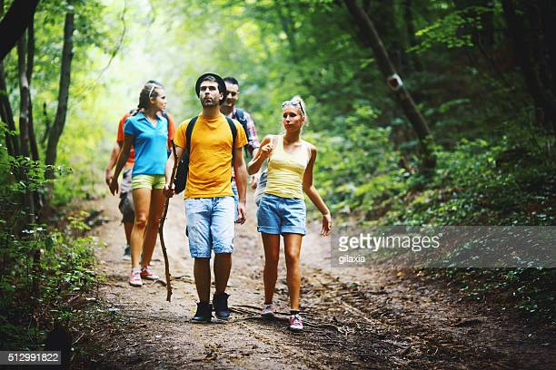 Friends hiking in forest.