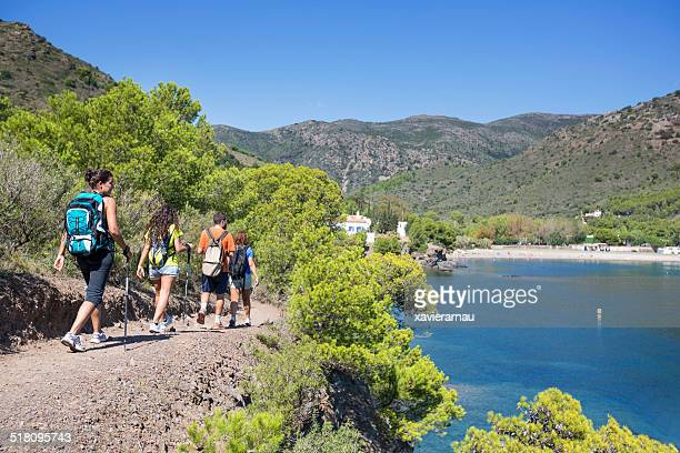 friends hiking in the mediterranean coast - girona stock photos and pictures