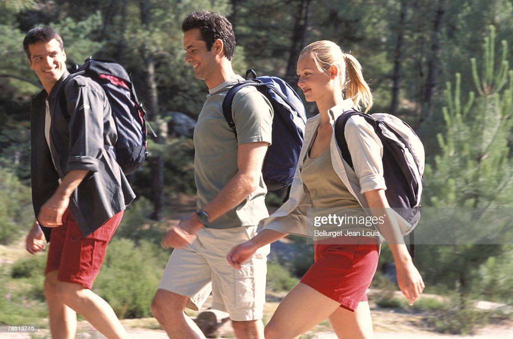 Friends hiking outdoors : Stock Photo