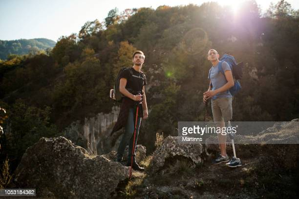 friends hiking - artificial limb stock photos and pictures