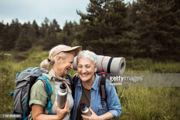 friends hiking - lgbtq  female stock pictures, royalty-free photos & images
