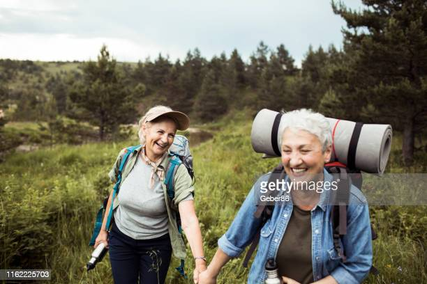 friends hiking - gay couple stock pictures, royalty-free photos & images