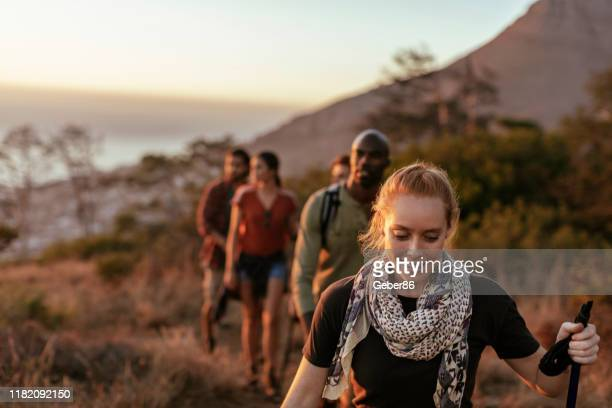 friends hiking - outdoor pursuit stock pictures, royalty-free photos & images