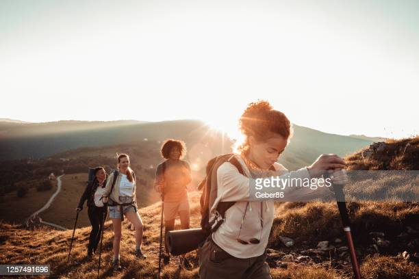 friends hiking - female friendship stock pictures, royalty-free photos & images