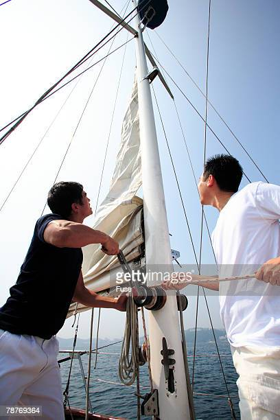 Friends Hoisting Sail