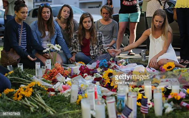 Friends hold hands to pray and remember shooting victims Veronica Weiss of Westlake and Katie Cooper Chino Hills on May 25 2014 outside the Alpha Phi...