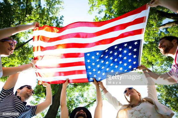 friends holding american flag - political party stock pictures, royalty-free photos & images