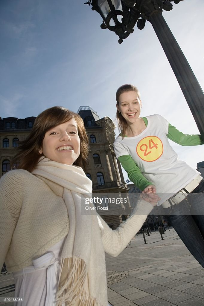 Friends holding hands : Stock Photo