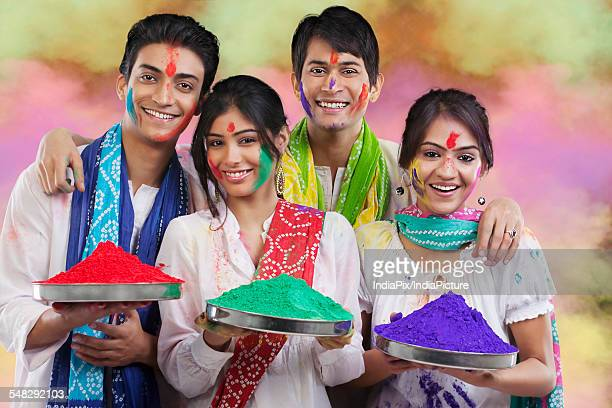 friends holding trays with colours - new generation stock pictures, royalty-free photos & images