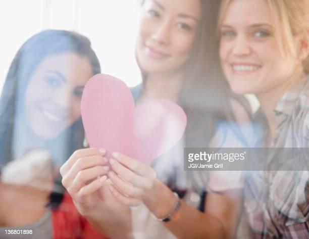 Friends holding valentine