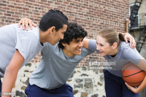 Friends huddling during basketball game