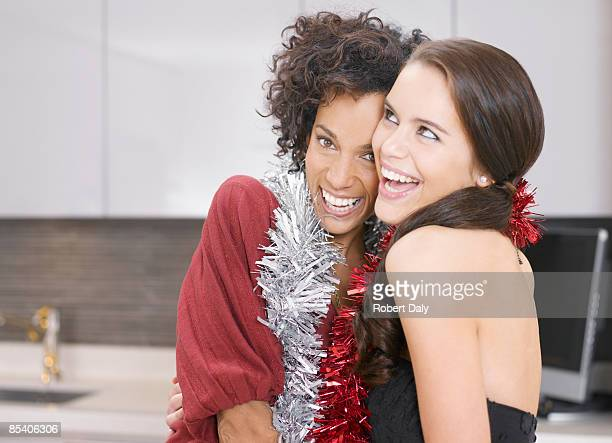 Friends hugging at Christmas party