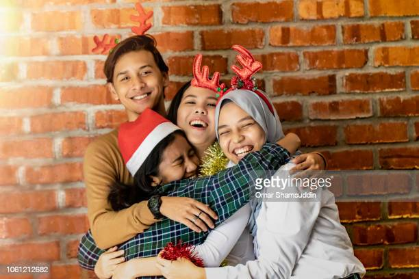 Friends hugging in Christmas costume