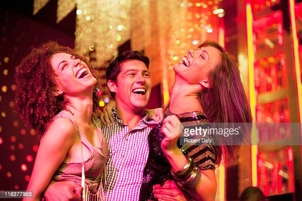 Friends hugging in nightclub