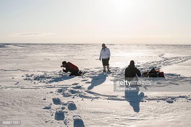 Friends Ice Fishing, Great Slave Lake, Yellowknife, Northwest Territories.
