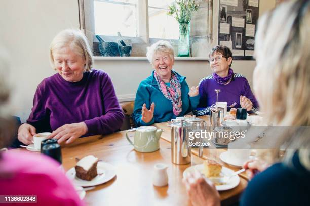 friends in a cafe - community center stock pictures, royalty-free photos & images