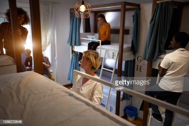 friends in a hostel - hostel stock pictures, royalty-free photos & images