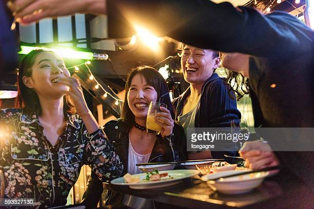 friends in a pub in japan - asian drink stock photos and pictures
