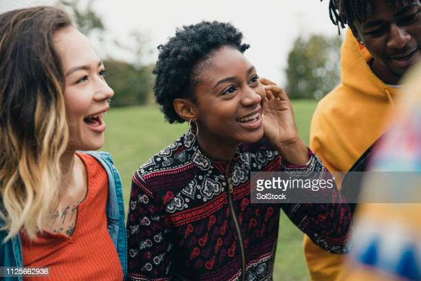 friends in a public park - teenager stock pictures, royalty-free photos & images