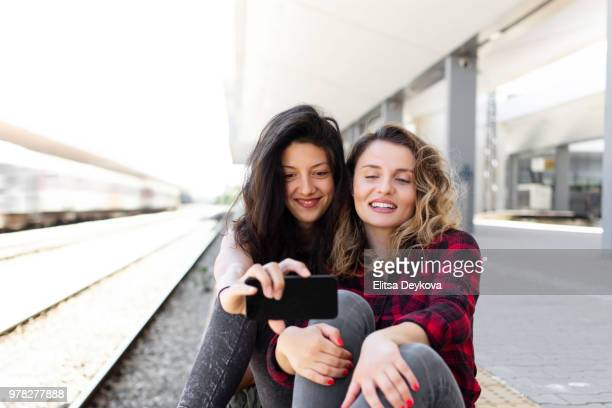 Friends in a rail-station platform
