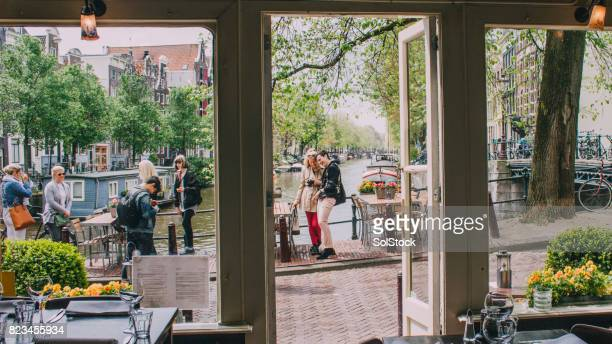 friends in amsterdam - amsterdam stock pictures, royalty-free photos & images