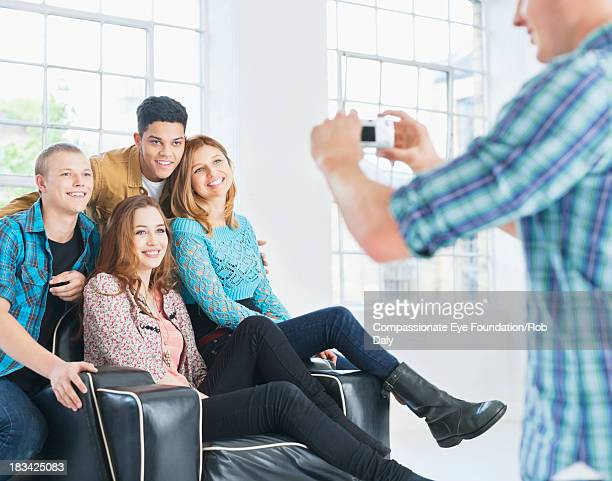 """friends in arm chair posing for photograph - """"compassionate eye"""" stock pictures, royalty-free photos & images"""