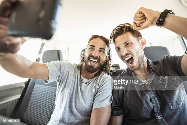 friends in back seat of car taking selfie - friends inside car stock photos and pictures
