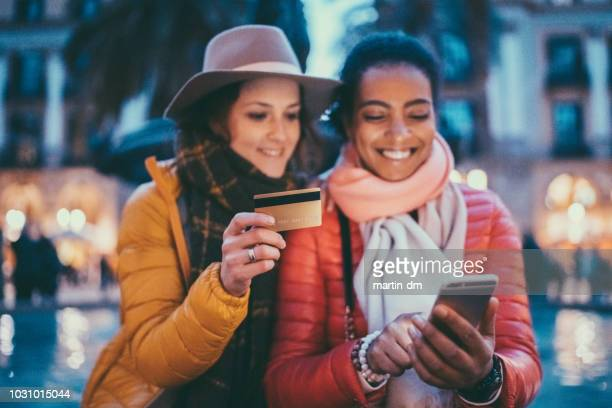 friends in barcelona booking hotel online - making a reservation stock photos and pictures