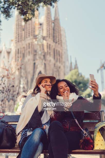 friends in barcelona making funny faces on video call - sagrada familia stock pictures, royalty-free photos & images