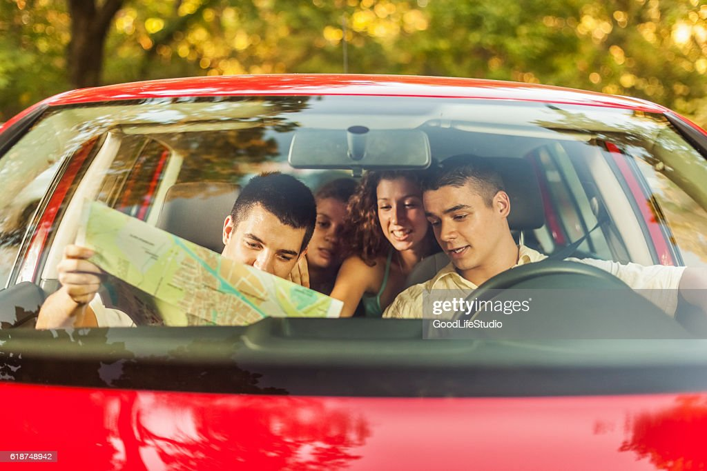 Friends in car going on vacation : Stock Photo