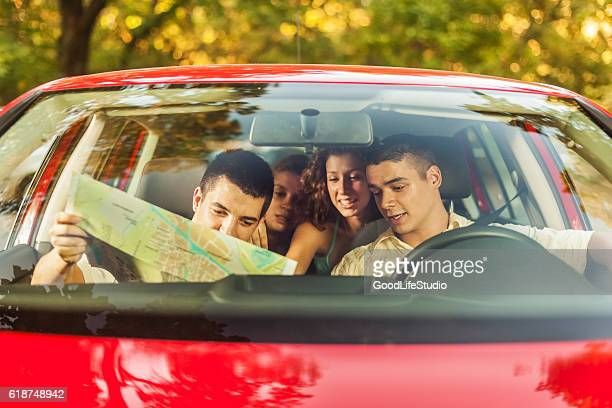 Friends in car going on vacation
