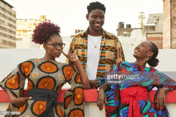 friends  in colorful clothes on roof terrace in the city, maputo, mozambique - mozambique stock pictures, royalty-free photos & images