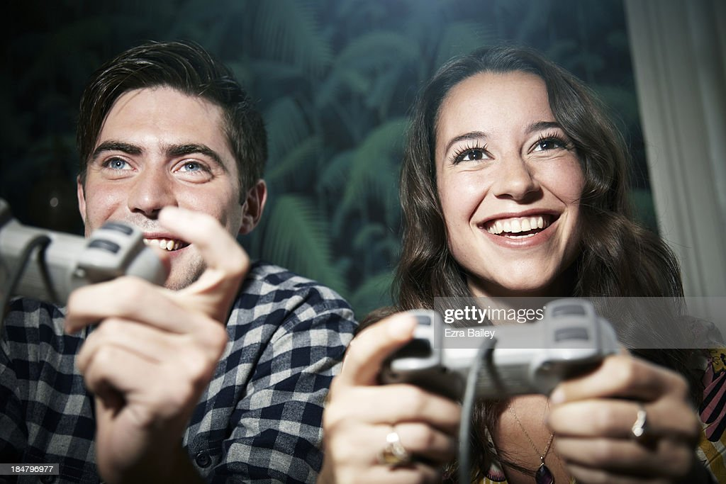 Friends in competition playing computer game. : Stock Photo