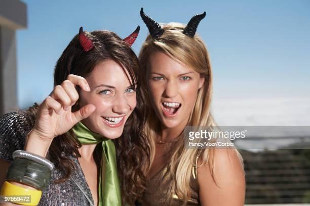friends in costume - devil costume imagens e fotografias de stock