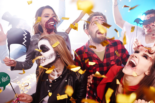 Friends in creepy costumes having fun at Halloween party - gettyimageskorea