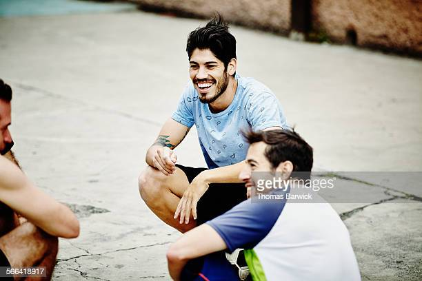 Friends in discussion after pick up soccer game