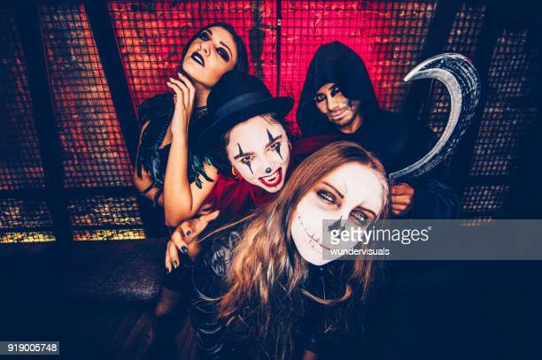 friends in halloween costumes taking photos in party photo booth - zombie makeup stock photos and pictures