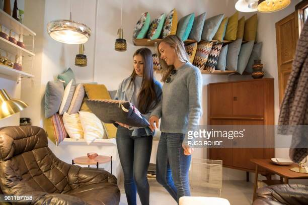 friends in homeware store looking at cushions - household equipment stock pictures, royalty-free photos & images