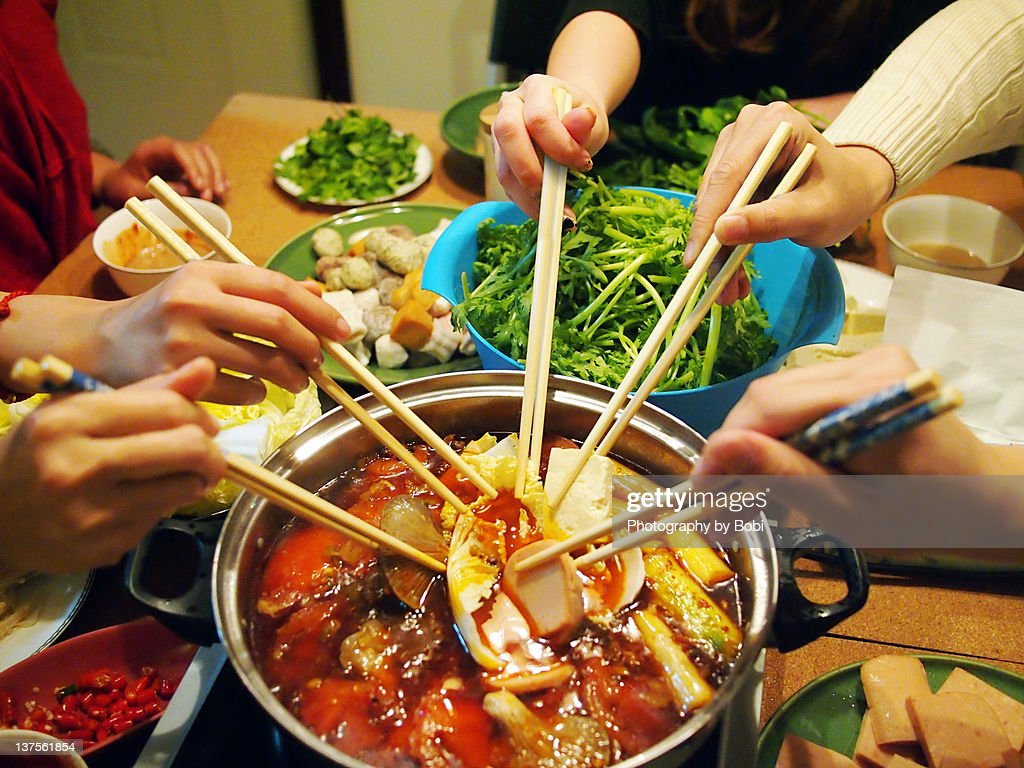Friends In House Party To Eat Hot Pot Stock Photo